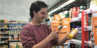 Customer shopping at Sainsburys Holborn Circus till-free store